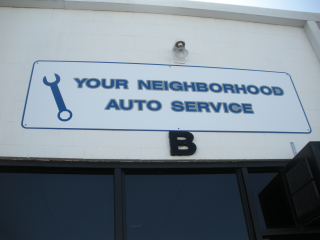 Your Negihborhood Auto Service Sign